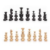 A TURNED WOODEN CHESS SET the kings 8.5cm high Condition: the four knights possibly reglued, one