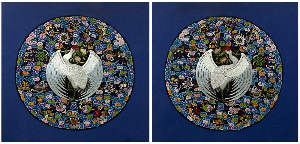Lot 422 - Pair of circular embroidered panels Chinese, 20th Century decorated with a central peacock in flight