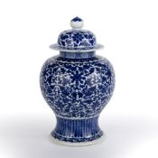 Blue and white baluster vase and cover Chinese, 19th Century decorated to the body with tightly