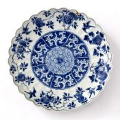 Blue and white dish Chinese, Kangxi period (1662-1722) with a shaped border, the centre decorated