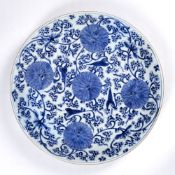 Large blue and white charger Chinese, Kangxi (1662-1722) painted with lotus flowers and trailing