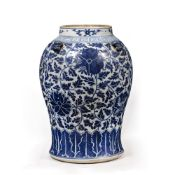 Blue and white vase Chinese, 19th Century decorated to the body in Indian lotus, with four lug