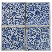 Set of four blue and white porcelain tiles Chinese, 19th Century of square form, painted with