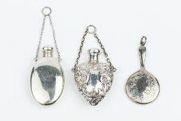 AN EDWARDIAN SILVER HEART SHAPED SCENT BOTTLE, repoussé decorated with scrolling foliage, by