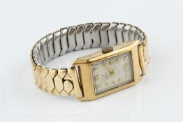 A GENTLEMAN'S 9CT GOLD CASED WRISTWATCH BY TUDOR, the rectangular silvered dial with gilt Arabic