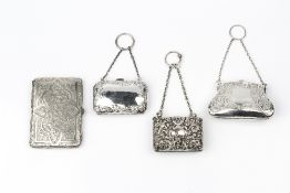 AN EDWARDIAN SILVER PURSE, embossed and engraved with birds and scrolling foliage, on chain, by