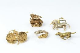 A COLLECTION OF JEWELLERY, comprising a 9ct two colour gold unicorn brooch by Harriet Glen, a 9ct