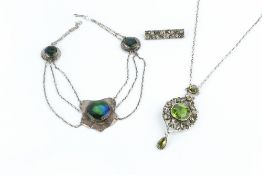 AN ARTS AND CRAFTS PENDANT NECKLACE, designed as a trio of hammered panels, each centred with a