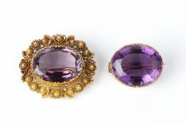 A 19TH CENTURY AMETHYST PANEL BROOCH, circa 1820-30, the oval mixed-cut amethyst bordered by