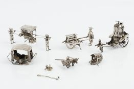 A CHINESE EXPORT SILVER MODEL PALANQUIN, with bearers, by Wang Hing, 11.5cm long; a similar small