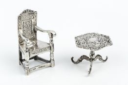 A LATE 19TH CENTURY GERMAN SILVER MINIATURE CHAIR, with open arms and tall panelled back, import