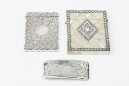 A VICTORIAN SILVER CARD CASE, of shaped rectangular outline, engraved with stylised foliage, by