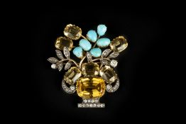 A DIAMOND AND VARI GEM-SET GIARDINETTO BROOCH, the old and rose-cut diamond edged vase issuing a