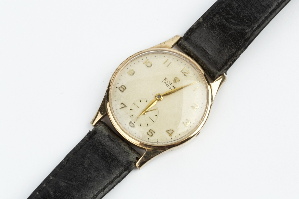 A GENTLEMAN'S 9CT GOLD 'PRECISION' WRISTWATCH BY ROLEX, the circular silvered dial with gilt