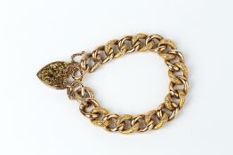 A LATE VICTORIAN/EDWARDIAN CURB-LINK BRACELET, of hollow construction, with alternate polished and
