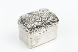 A LATE VICTORIAN SILVER RECTANGULAR BOX AND COVER, the domed cover repoussé decorated with a