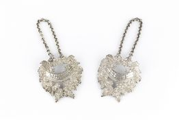 A PAIR OF GEORGE III SILVER LARGE DECANTER LABELS, for Port and Sherry, each cast as a wreath of