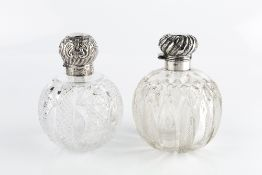 A LATE VICTORIAN SILVER TOPPED CUT GLASS SCENT BOTTLE, the hinged top repoussé decorated with
