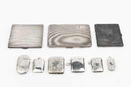 A COLLECTION OF SIX VICTORIAN AND EDWARDIAN SILVER VESTA CASES, five of them with foliate engraved