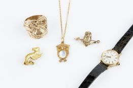A COLLECTION OF JEWELLERY, comprising a moonstone and ruby set owl pendant, stamped '750', on a