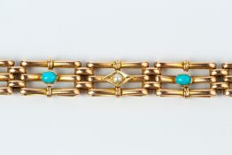A LATE VICTORIAN/EDWARDIAN GEM SET BRACELET, of gate-link design, alternately spaced with half