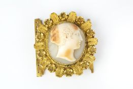 A 19TH CENTURY SHELL CAMEO CLASP, the oval shell cameo carved to depict a classical female