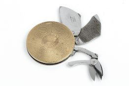 A 9CT GOLD CIRCULAR MANICURE TOOL, by Asprey & Co. Ltd, with engine turned decoration, fitted with