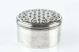 A GEORGE III SILVER CIRCULAR TOILET OR POT POURRI BOX, the cover pierced and engraved with