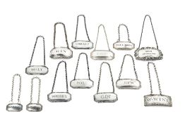 FIVE MODERN SILVER DECANTER LABELS, for Sherry, Gin, Malt, Port and Whisky, another with shaped