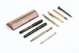 A 9CT GOLD CASED 'BAKER'S POINTER PENCIL', a gold plated pencil, two silver 'Yard-o-Led' pencils,