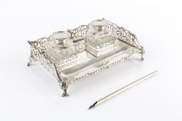 A LATE VICTORIAN SILVER INKSTAND, with shaped and pierced decorated three quarter gallery, fitted