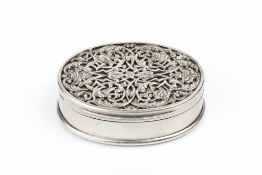 A VICTORIAN SILVER OVAL SNUFF BOX, the hinged cover with pierced stylised foliate overlay, having