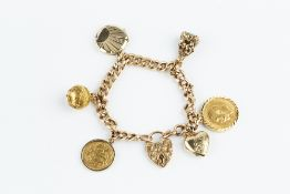 A CHARM BRACELET, the curb-link bracelet of part-textured finish, with foliate engraved padlock