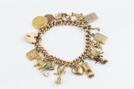 A CHARM BRACELET, the hollow curb-link bracelet stamped '15', with 15ct gold padlock clasp