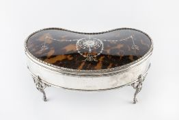 A SILVER AND TORTOISESHELL KIDNEY SHAPED LARGE JEWELLERY CASKET, the hinged lid piqué inset with a