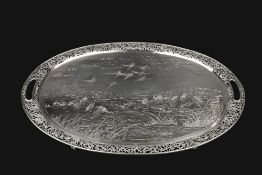 A LATE 19TH CENTURY CHINESE EXPORT SILVER OVAL TEA TRAY, by Wang Hing, engraved with numerous