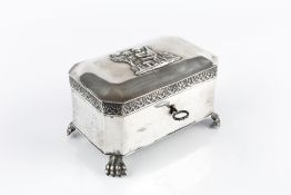 A 19TH CENTURY GERMAN SILVER CASKET, of canted rectangular form, the lid applied with a cherub