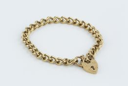 A 9CT GOLD CURB-LINK BRACELET, with padlock clasp, length 18.5cm