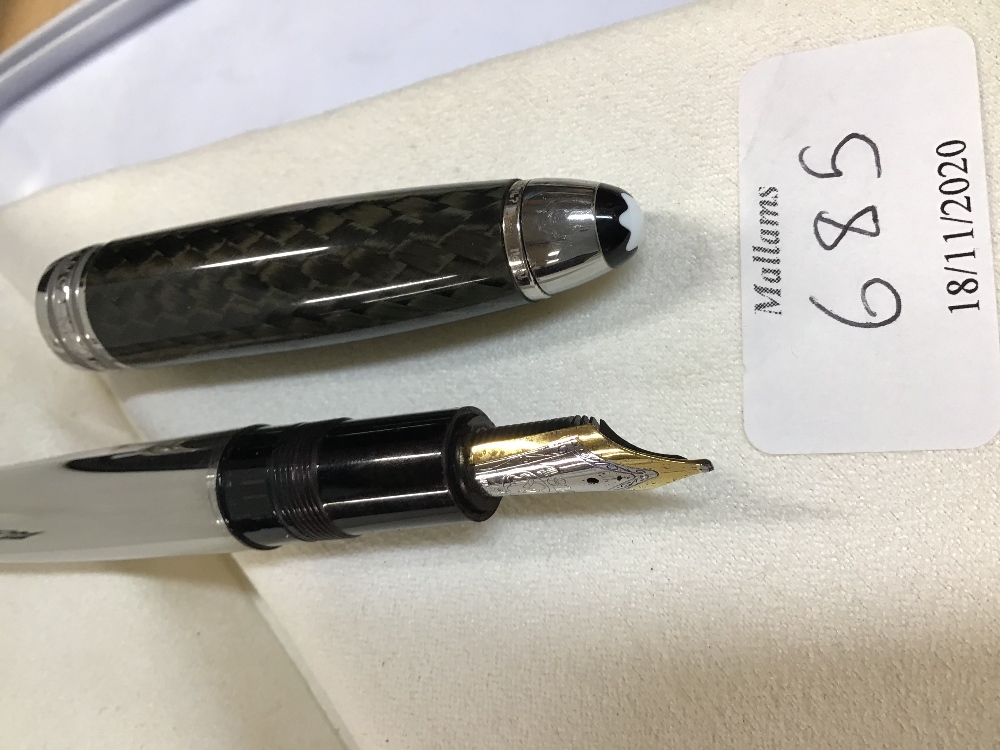 A MONT BLANC MEISTERSTUCK FOUNTAIN PEN with carbon steel body and chequered lid, and with service - Image 5 of 7