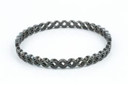 Jack Spencer Oxidised silver bangle abstract twist design with shield-shaped maker's mark hallmarked