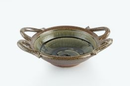 Walter Keeler (b.1942) Shallow bowl with applied twin-handles to both sides, the centre with blue