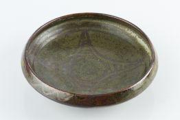 Ladi Kwali (1925-1984) at Abuja Pottery Shallow bowl green glaze, decorated with geometric motif