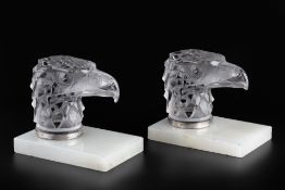 René Lalique (1860-1945) A pair of Tete D'Aigle car mascots, circa 1930 frosted glass on hardstone