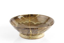 Edward Hughes (1953-2005) Footed bowl green glaze impressed potter's seal 23cm diameter.