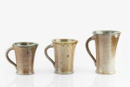 Walter Keeler (b.1942) Three jugs salt-glazed with brown glaze to exterior and green glaze to