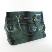 An Escada green snakeskin tote bag,