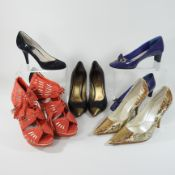 A pair of Dior snakeskin high heeled shoes, size 37,