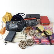 *Withdrawn* A Prada black leather clutch bag, 21cm, together with a Christian Dior cream clutch bag,