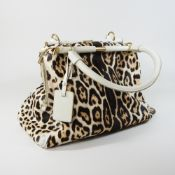 An Yves Saint Laurent cream leather and fur tote bag, bearing a label rive gauche,