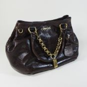 A Prada brown leather designer handbag, with a gilt chain link handle,
